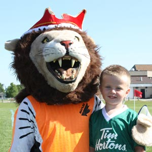 Maples Mascot with kid